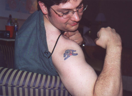 kianor AGAIN, his taz tattoo.